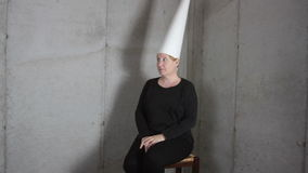 Woman in Dunce Cap Making Faces stock video