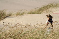Woman at Dunes. With hat Stock Photography