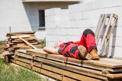 Woman taking break on construction site stock image