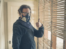 Woman with dust mask and goggles giving thumbs up Royalty Free Stock Photos