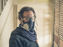 Woman with dust mask and goggles in hallway Stock Photography