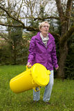 Woman with dustbin Royalty Free Stock Images