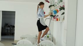 She cleans the dust in the hotel and dancing stock video footage
