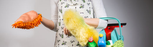Woman with duster Stock Image