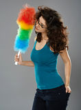 Woman with duster, studio shot Stock Photo