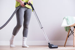 Woman dusting dirty apartment Stock Photography