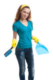 Woman with a dustpan and brush Royalty Free Stock Image