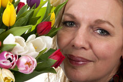 Woman with Dutch tulip flowers Stock Image
