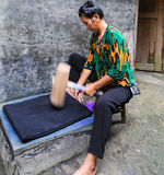 The woman dyeing cloth in zhaoxin,guizhou,china Royalty Free Stock Photo