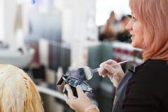 Woman dyeing hair Royalty Free Stock Photo