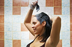 Woman dyeing hairs. Pretty beautiful young woman dyeing hairs royalty free stock images