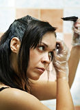 Woman dyeing hairs Royalty Free Stock Photography