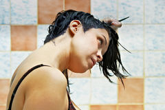Woman dyeing hairs. Pretty beautiful young woman dyeing hairs stock images
