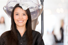 Woman dyeing her hair Stock Photography
