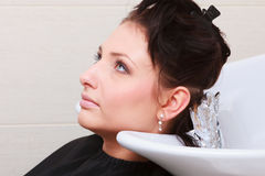 Woman dying hair in hairdressing beauty salon. Hairstyle. Stock Photo