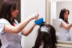 Woman dying hair in hairdressing beauty salon. Hairstyle. Royalty Free Stock Image