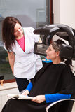 Woman dying hair in hairdressing beauty salon. Hairstyle. Royalty Free Stock Images