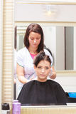 Woman dying hair in hairdressing beauty salon. By hairstylist. Stock Photography