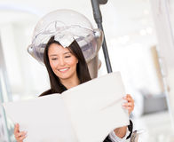 Woman dying her hair Royalty Free Stock Photo