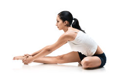 Woman in dzany sirshasana yoga position Stock Image
