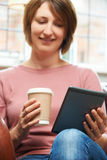 Woman With E-Book Reader In Cafe Stock Photography