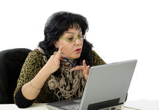 Woman is e learning teacher. Mature woman is e learning teacher in internet Royalty Free Stock Photography