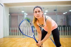 Woman eager to play squash Stock Photos
