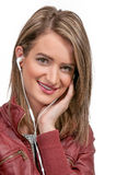 Woman with ear buds Stock Photos