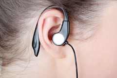 Woman ear with headphones Royalty Free Stock Photos