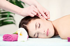 Woman on ear massage in salon royalty free stock photography