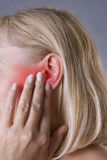 Woman with earache, ear pain closeup. With red spots stock images
