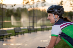 Woman on early morning cycling. Sportswoman Stock Photography