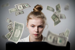 Woman earns dollars on the internet Stock Images