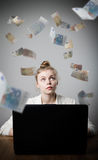 Woman earns Euro on the internet Royalty Free Stock Image