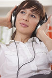 Woman with earphones Royalty Free Stock Photo