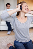 Woman with earphones on the carpet Royalty Free Stock Photo