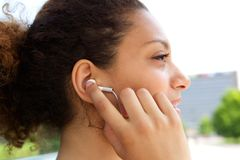Woman with earphones in ears Royalty Free Stock Photo