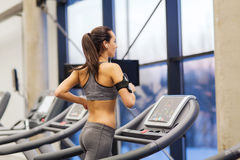 Woman with earphones exercising on treadmill Royalty Free Stock Photography
