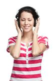 Woman with earphones Stock Images