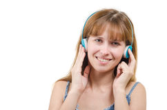 The woman in earphones listens to music Stock Images