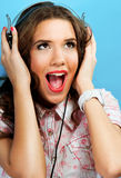 Woman with earphones singing Stock Photography