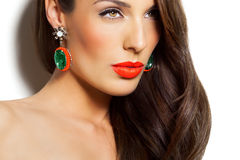 Woman With Earring. Closeup of a model with long dark hair and earring Royalty Free Stock Photos
