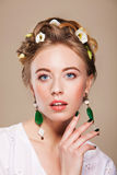 Woman with earrings and flowers in her hair Royalty Free Stock Photo