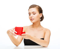 Woman with earrings, wedding ring and gift box Stock Photography