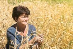 Woman among ears Royalty Free Stock Photos