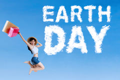 Woman with Earth Day text on sky Stock Photography