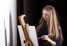Woman and easel. Stock Image