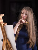 Woman and easel. Stock Images