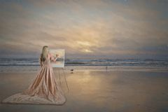 Woman painting. Woman with easel painting beach and ocean scene stock photos