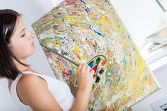 Woman with an easel paints a picture Royalty Free Stock Photos